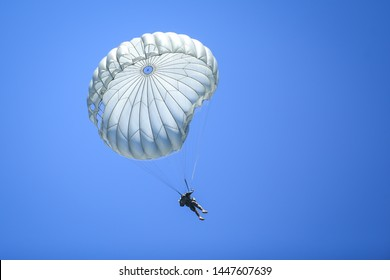 Boboc, Romania - May 22, 2019: Military paratroopers jump from an Alenia C-27J Spartan military cargo plane.