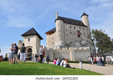 BOBOLICE, POLAND - SEPTEMBER 19: People admire medieval castle on September 19, 2011 in Bobolice, Poland. It belongs to the Lasecki family, who decided to rebuild it in 1999.