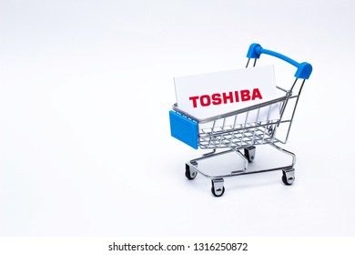 BOBRUISK, BELARUS - JANUARY 30, 2019: Shopping cart on a white background in which the business card of the corporation TOSHIBA, the brand