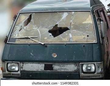 BOBRUISK, BELARUS - JULY 5, 2018: Broken and shot by bullets car, crime, robbery