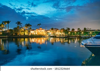 Boca Raton buildings along Lake Boca Raton at sunset, Florida.