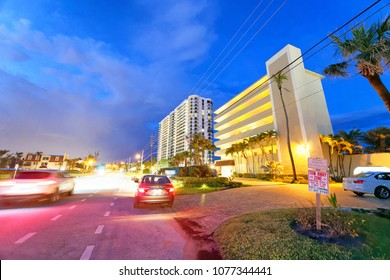 BOCA RATON, FL - APRIL 10, 2018: Boca Raton streets at night. The city is a famous town of Florida coast.