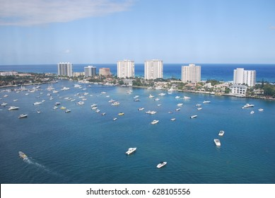 Boca Raton, Florida skyline with boats in water and buildings