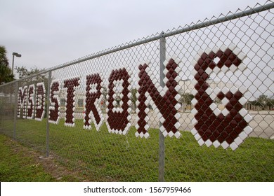 "BOCA RATON, FLORIDA / USA - NOVEMBER 17 2019:  ""MSD (Marjory Stoneman Douglas) Strong"" appears in bold letters on the football field fence outside Boca Raton Community High School."