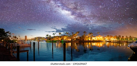 Boca Raton skyline and reflections on a starry night, Florida.