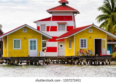 BOCAS DEL TORO, PANAMA - FEB 22, 2018: Colorful Caribbean wooden buildings over the water with boats at dock, Colon island, Bocas del Toro, Panama. Islands are popular tourist destination.