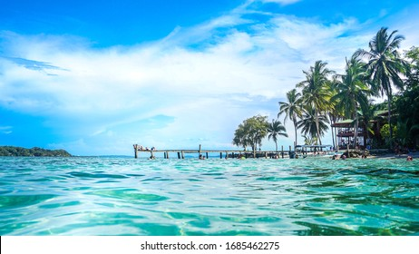 Bocas del Toro, Panama-March 2018: The tropical environment of a beautiful island of Panamanian archipelago with white sand beaches and tirquise clear water of the Caribbean sea during a sunny day.