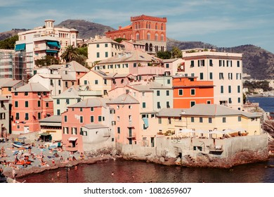 Boccadasse, Italy - August, 15: busy beach under the old walls of Boccadasse fishing village on August, 15, 2017.