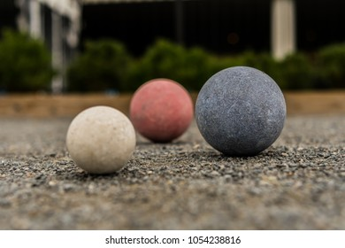 Bocce Balls on Gravel Blue in Focus