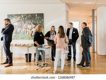 BOCHUM, GERMANY – AUGUST 30, 2018: People standing and talking at bar tables in Bochum, Germany