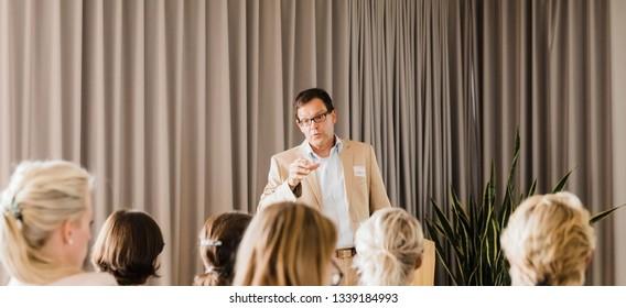 BOCHUM, GERMANY – AUGUST 30, 2018: Audience listening to male speaker in Bochum, Germany
