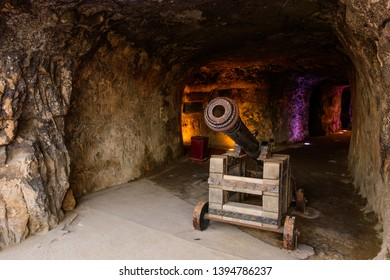 The Bock, Luxembourg City, Luxembourg - September 25, 2017: An old cannon aims out of the Bock Casemates overlooking the Alzette Valley