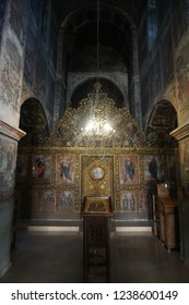 BODBE, GEORGIA - AUGUST 18, 2018 Bodbe Monastery Church Iconostasis with Frescoes Icons and Lamp