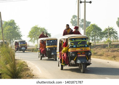 BODH GAYA - BIHAR - INDIA - 05 JANUARY 2018. A group of Buddhist monks are on a auto rickshaw (Tuc Tuc) in Bodh Gaya. Bodh Gaya is a religious site in the Indian state of Bihar, India.