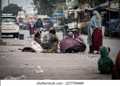 Bodh gaya, India -January 7, 2019 :The group of beggars was sitting and burning fire on the side of the road in the winter in the morning in Bodh Gaya, India,