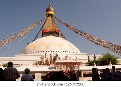 "Bodhnath, Nepal - October 9 2014"" The beautiful white monastery called bodhnath is very popular in Katmandu"