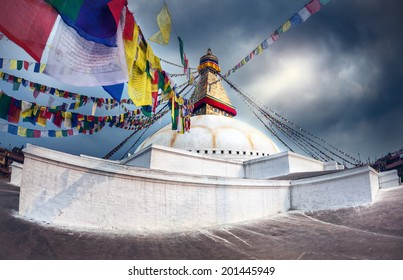 Bodhnath stupa at overcast cloudy sky in Kathmandu valley, Nepal
