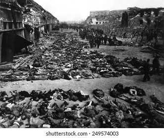 Bodies of dead inmates fill the yard of Nordhausen, a Gestapo concentration camp. Photo was taken shortly after the camp's liberation by U.S. Army. April 12, 1945, Germany, World War 2.
