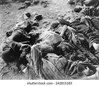 Bodies of German slaves lie where they died of starvation on prison floors of a concentration camp in Nordhausen, Germany after liberation by First U.S. Army on April 11, 1945.