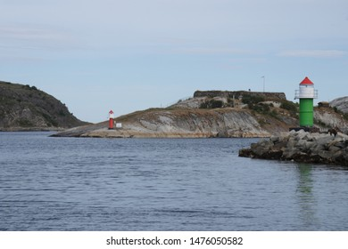 BODO, NORDLAND COUNTY / NORWAY - AUGUST 10 2019:  Outdoor view of landscape of a lighthouse at Bodo's coast near the entrance to Bodo (Bodø) harbour, Nordland county, Norway