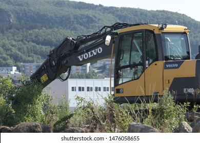 BODO, NORDLAND COUNTY / NORWAY - AUGUST 03 2019: Yellow excavator on a construction site