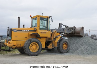 BODO, NORDLAND COUNTY / NORWAY - AUGUST 03 2019: Yellow well loader during the work