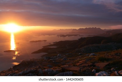 BODO, NORDLAND COUNTY / NORWAY - JULY 04 2019: Midnight sun view from the Keiservarden mountain near city of Bodo (Bodø)