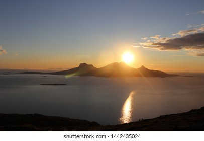 BODO, NORDLAND COUNTY / NORWAY - JULY 04 2019: Midnight sun view from the Keiservarden mountain near city of Bodo (Bodø).  View on the Landegode island