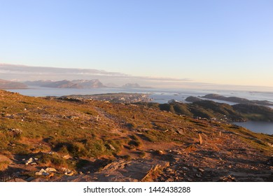 BODO, NORDLAND COUNTY / NORWAY - JULY 04 2019: Midnight view on the city of Bodo (Bodø) from the Keiservarden viewpoint, Norway