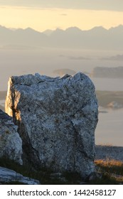 BODO, NORDLAND COUNTY / NORWAY - JULY 04 2019:  Stone in the midnight light on the top of Keiservarden mountain near city of Bodo (Bodø)