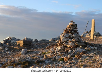 BODO, NORDLAND COUNTY / NORWAY - JULY 04 2019:  Pyramid of stones on the top of Keiservarden mountain near city of Bodo (Bodø)