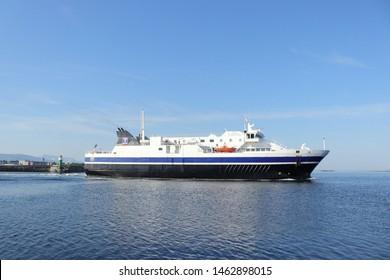 BODO, NORDLAND COUNTY / NORWAY - JULY 27 2019: Norway sea ferry near the Bodo (Bodø), Nordland, Norway. Passenger ship Bodø