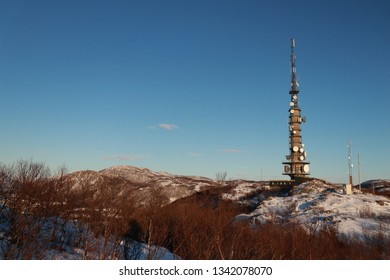 BODO, NORDLAND COUNTY / NORWAY - MARCH 09 2019: The TV antenna at Linken mountain is a landmark in Bodø city.  This TV antenna connects the Lofoten Islands to Mainland