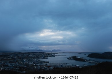 BODO, NORDLAND COUNTY / NORWAY - NOVEMBER 18 2018:  Morning view on the city of Bodo (Bodø) from the mountains, Norway