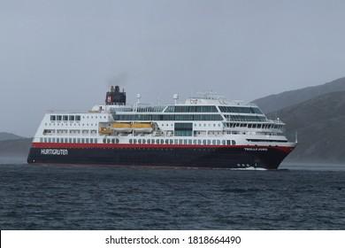 BODO, NORDLAND COUNTY / NORWAY - SEPTEMBER 20 2020: Trollfjord cruise ship near the Bodo harbour. Thunderstorm on the Norwegian sea