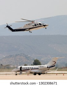 Bodrum, Mugla / Turkey - June 9th, 2018: A Sikorsky s-76c Spirit with tail no. TC-HKA lands next to an Embraer emb 550 legacy 500 business jet with tail no. OD-CXJ at Bodrum - Milas Airport.