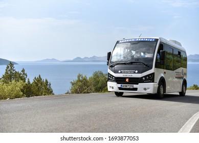Bodrum / Turkey - 10.11.19: City route minibus Karsan Jest drive by coastal road. Text on body in translate from turkish - Mugla Metropolitan Municipality special public transportation vehicle.
