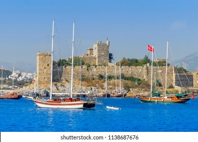 Bodrum, Turkey, 25 October 2010: Gulet Wooden Sailboats and Bodrum Castle