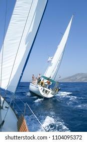 Bodrum, Turkey - August 03, 2008: Sailing crew on a sailboat racing in Bodrum - Turkey 2008