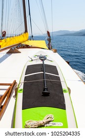 BODRUM, TURKEY, JULY 2015, a paddle board and a kayak tied up on top of a sailing boat on a sunny summer day at sea.