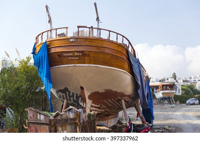 Bodrum, Turkey - November 12, 2015: A yacht being repaied at a dockyard in the coast of Bodrum, Turkey's popular summer resort town located by the Aegean sea, Turkish Riviera on November 12, 2015