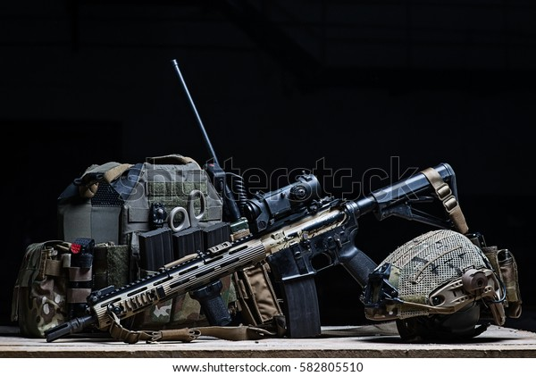 Body armor cover,assault rifle with a sight and helmet on black background/Bulletproof vest, rifle and helmet