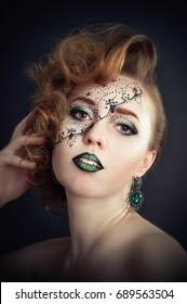 Body art on face, beautiful girl posing