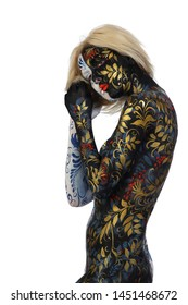 Body art portrait of a girl in the style of Khokhloma and Gzhel on a white background studio
