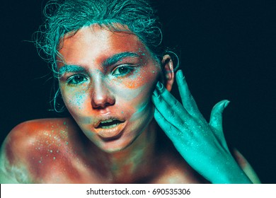 Body art woman pink face beauty with blue hair and hand. Beautiful art skin