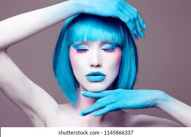 Body art  young woman with Blue Hair. conceptual halloween make-up. painted white powder skin beauty girl
