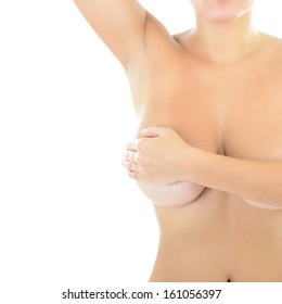 Body of beautiful woman covering her breast and showing armpit, over white