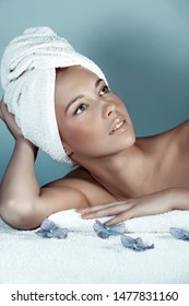 Body and beauty care, portrait of a pretty woman with towel on head relaxing after bath on massage table, enjoying day spa, healthy treatment, luxury lifestyle concept