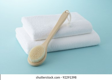 body brush on white towels