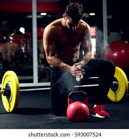 Body builder gym preparing for workout. Weightlifter kettle bell.